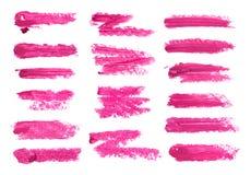 Grupo grande de borrão fúcsia do batom isolado no fundo branco Amostra borrada do produto de composição imagens de stock