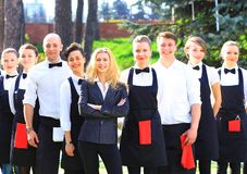 Grupo grande de camareros Imagen de archivo libre de regalías
