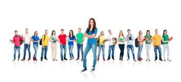 Grupo grande de estudiantes adolescentes aislados en blanco Fotografía de archivo libre de regalías