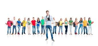 Grupo grande de estudiantes adolescentes en blanco Fotografía de archivo libre de regalías