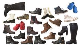 Grupo grande de zapatos aislados Imagen de archivo libre de regalías