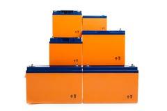 grupo industrial de las baterías de plomo en blanco Fotografía de archivo