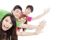 Grupo joven con las manos para arriba Imagen de archivo