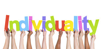 Grupo multiétnico de manos que llevan a cabo individualidad Fotografía de archivo
