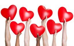 grupo Multi-étnico da mão de pessoa que guarda o coração Fotografia de Stock Royalty Free