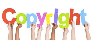 Grupo multi-étnico de mãos que guardam Copyright Imagens de Stock