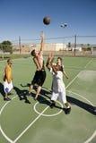 Grupo Multiracial que joga a bola da cesta Imagem de Stock Royalty Free