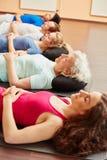 Grupo que medita después de clase de la yoga foto de archivo libre de regalías