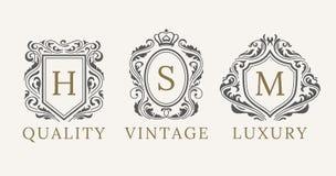 Grupo real retro do Logotype dos protetores do vintage Elementos luxuosos do projeto do logotipo do calligraphyc do vetor Sinais  ilustração stock