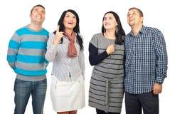 Grupo surpreendido dos povos que olha acima Foto de Stock Royalty Free