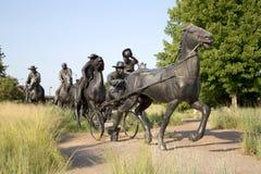 Grupowa Brązowa rzeźba w Centennial ziemi Biega zabytek zdjęcie stock