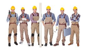 Grupp av arbetare med utrustning Royaltyfri Bild
