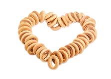 Grupp av baglar som ut läggas i form av hjärta Arkivfoton