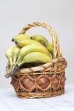 Grupp av bananer i korg Royaltyfria Bilder