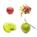Grupp av bananer, kokosnöt, äpple och drakefrukt som isoleras på whit Royaltyfria Foton