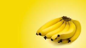 Grupp av bananer som isoleras på gul bakgrund Arkivfoto