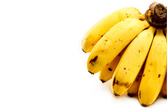 Grupp av bananer som isoleras på vit bakgrund med kopieringsutrymme royaltyfria foton