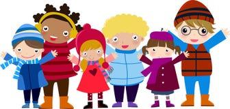 Grupp av barn och vintern Arkivbild