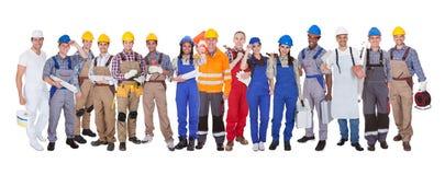 Grupp av byggnadsarbetare royaltyfri fotografi