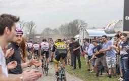 Grupp av cyklister - Paris-Roubaix 2018 Fotografering för Bildbyråer