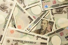 Grupp av den japanska sedeln 10000 yen bakgrund Arkivbilder