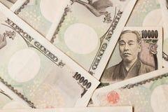 Grupp av den japanska sedeln 10000 yen bakgrund Royaltyfri Fotografi