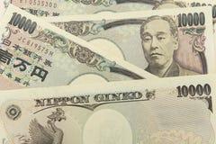 Grupp av den japanska sedeln 10000 yen bakgrund Royaltyfria Foton