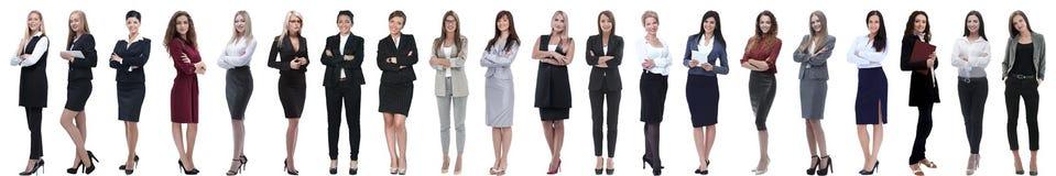 Grupp av den lyckade unga affärskvinnan som i rad står arkivfoto