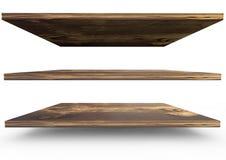 Grupp av den tomma wood bokhyllan för produktskärm i w Arkivbild