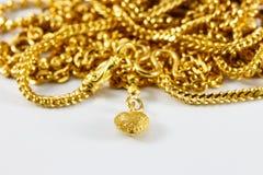 Grupp av det guld- halsband- och guldarmbandet Arkivbild