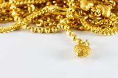Grupp av det guld- halsband- och guldarmbandet Arkivfoto
