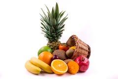 Grupp av exotiska frukter på en vit bakgrund Arkivbild