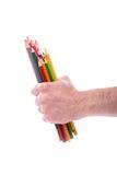 Grupp av färgblyertspennor i händer Fotografering för Bildbyråer