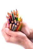 Grupp av färgblyertspennor i händer Royaltyfri Bild