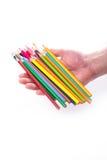 Grupp av färgblyertspennor i händer Royaltyfri Fotografi