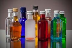 Grupp av färgrika små flaskor Royaltyfri Fotografi