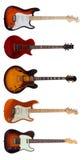Grupp av fem elektriska gitarrer på vit bakgrund royaltyfria foton