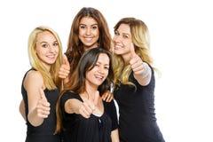 Grupp av flickor med tummar upp Royaltyfri Foto