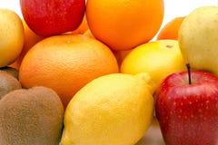 Grupp av frukter som isoleras på en vit bakgrund Royaltyfri Fotografi