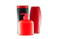 Grupp av fyra flaskor för hygienprodukter. royaltyfri fotografi