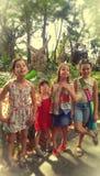 Grupp av fyra unga flickor Arkivbild