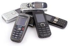 Grupp av gamla mobiltelefoner Fotografering för Bildbyråer
