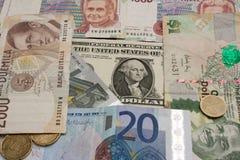 Grupp av gamla och aktuella pengar royaltyfria foton