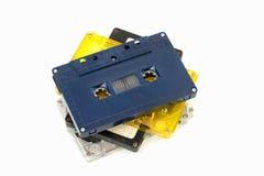 Grupp av gammala kassettband på vit bakgrund Royaltyfri Fotografi