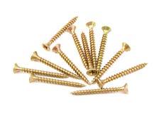 Grupp av guld- skruvar Royaltyfri Bild