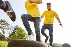 Grupp av gummihjul för ungdomaröverkörda bil royaltyfri fotografi