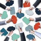 Grupp av händer som rymmer anförandebubblor Royaltyfri Foto