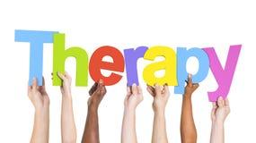 Grupp av händer som rymmer terapi Royaltyfri Fotografi