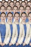 Grupp av identiska unga affärskvinnor Arkivbild
