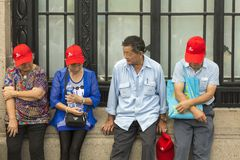 Grupp av kinesiska turister som tar ett avbrott Royaltyfri Foto